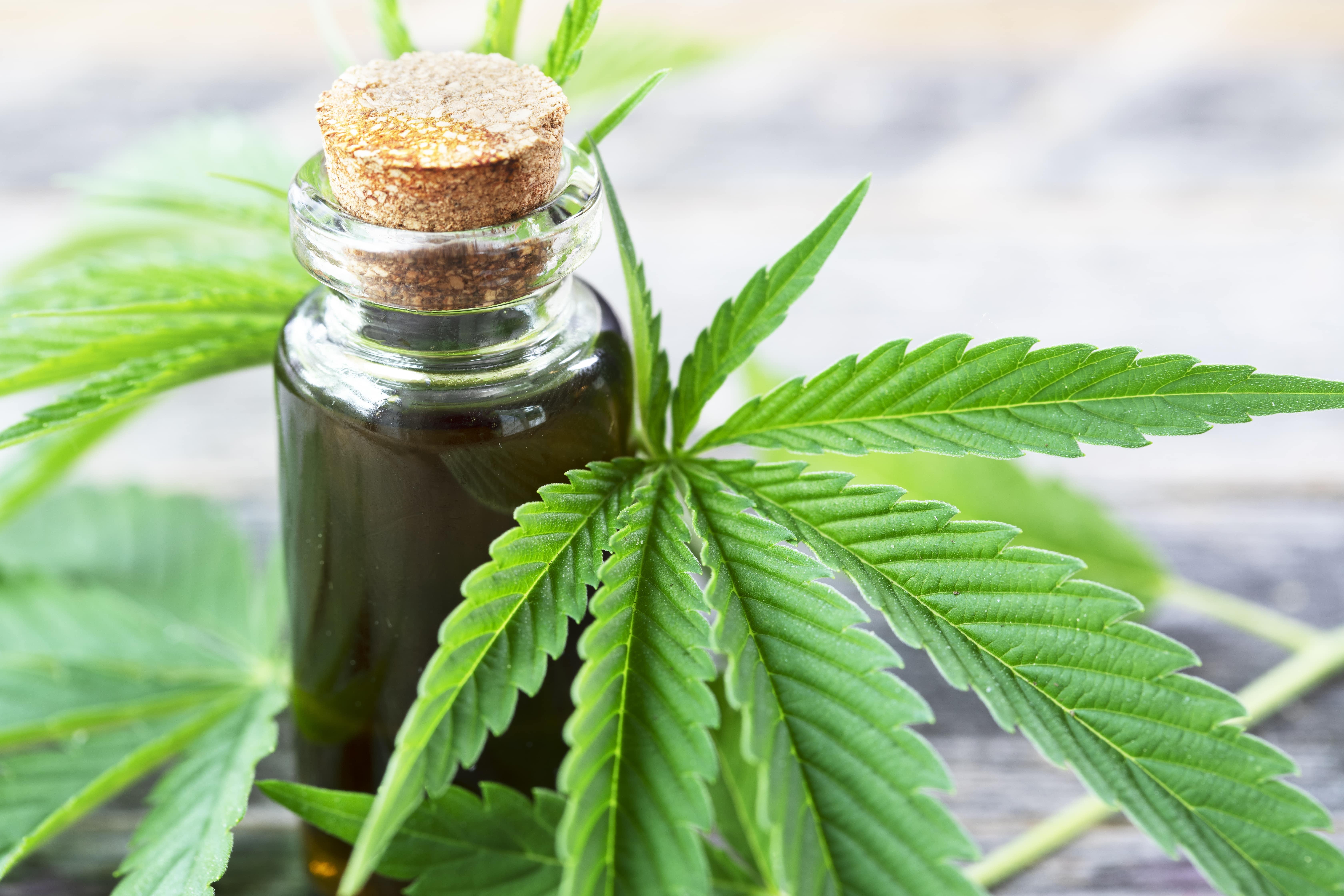 Cannabis with cannabis in vial-min